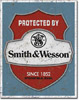 Protected by Smith & Wesson Tin Sign